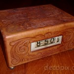 Lawson with tooled leather case. (Clock has dual displays, fron