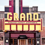 Grand Theater - Maine. The burgundy color appears to be PPG Carrara glass.